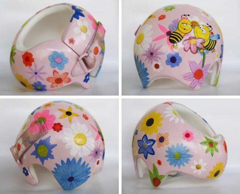 Babyhelm mit Bienen und Blumen